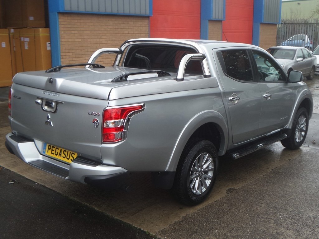 mitsubishi l200 series 5 longbed top up cover tonneau lid with styling bars pegasus 4x4 uk. Black Bedroom Furniture Sets. Home Design Ideas